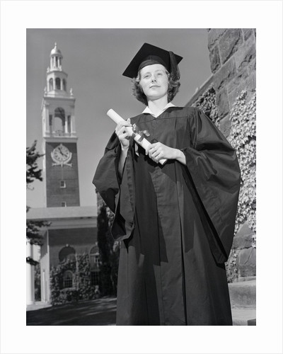 Woman in Mortarboard and Gown by Corbis