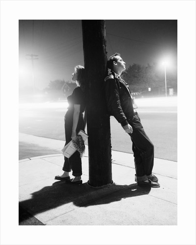 Teenagers Leaning on Utility Pole by Corbis
