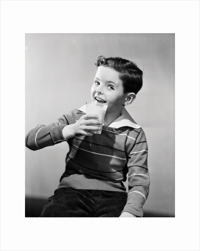 Smiling Boy with a Glass of Milk by Corbis