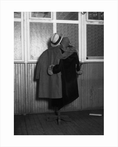 Hanging Coats Posed as an Embracing Couple by Corbis