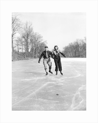 Couple Ice Skating by Corbis