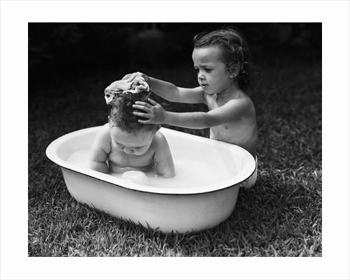 Baby Siblings Taking a Bath by Corbis