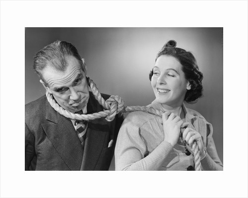 Wife Leading Husband with Noose by Corbis