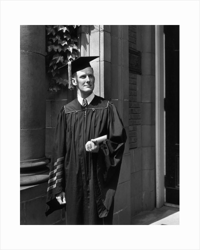 Princeton University Graduate in Gown and Mortarboard by Corbis