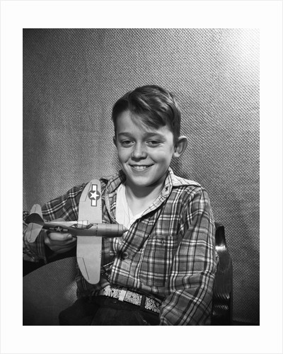 Boy with Model Plane by Corbis