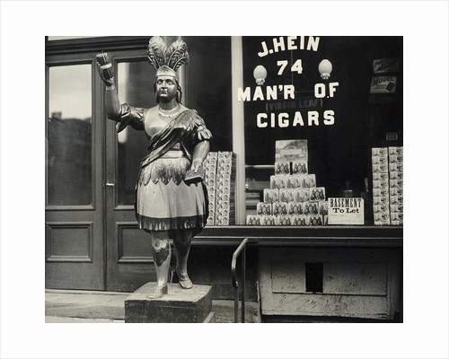 Wooden Statue In Front Of Cigar Shop by Corbis