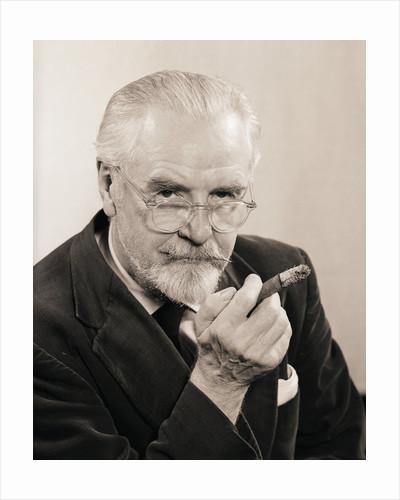 Bearded Man Holding a Cigar by Corbis