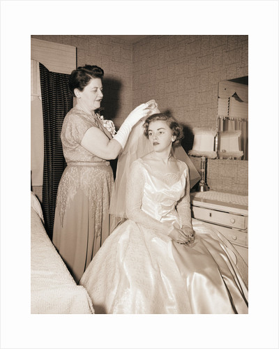Mother Putting Bridal Veil on Daughter by Corbis