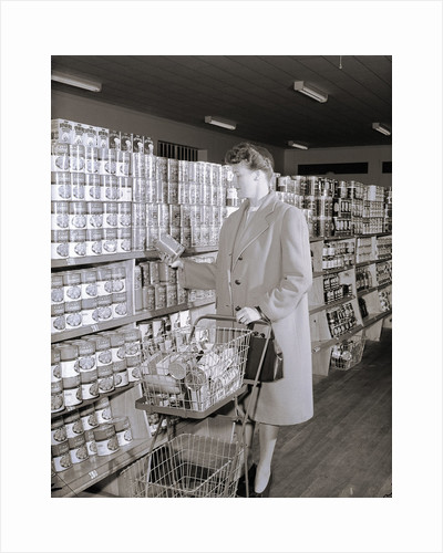 Woman Buying Food In Grocery Store by Corbis