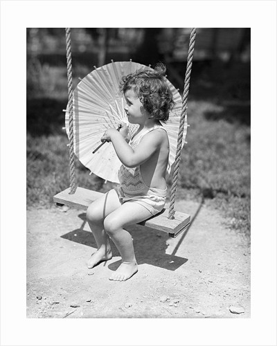 Girl on Swing Holding Parasol by Corbis
