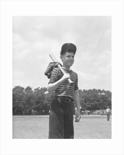 Boy Holding a Baseball Bat by Corbis