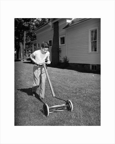 Boy Pushing Manual Lawnmower by Corbis