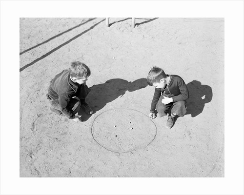 Two Boys Playing Marbles by Corbis