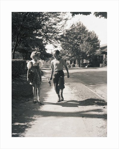 Boy and Girl Walking to School by Corbis