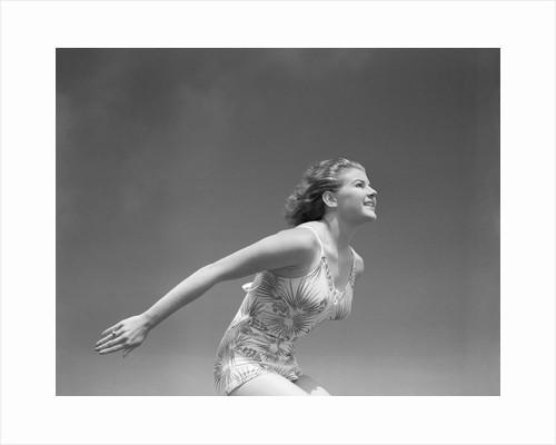 Woman Preparing to Jump by Corbis