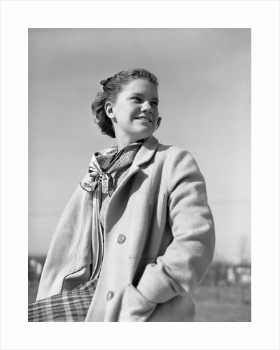 Teenager Wearing Coat and Scarf by Corbis