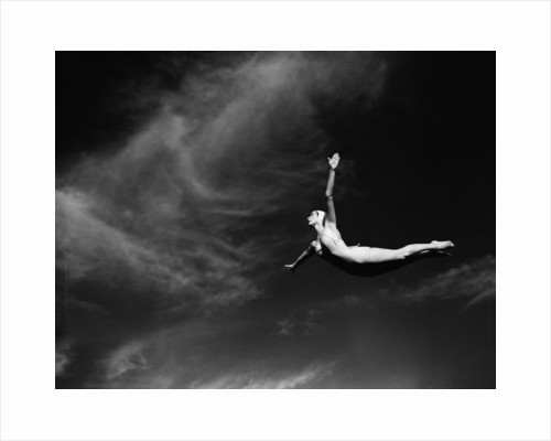 Woman Performing Swan Dive by Corbis