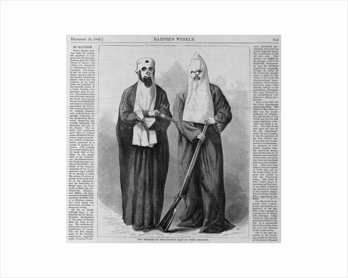 Page with text and diagram. Two members of the Ku-Klux-Klan in their disguises by Corbis