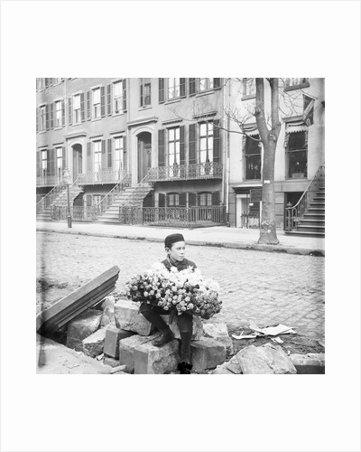 Boy Selling Flowers by Corbis