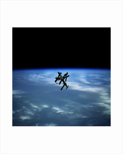 Mir Space Station Orbiting Earth by Corbis