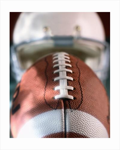 Football and Football Helmet by Corbis