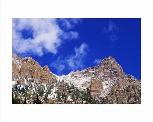 Fresh Snow on Mountain Peaks by Corbis