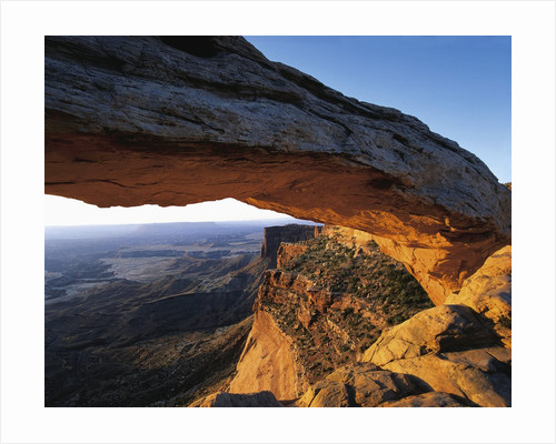 Mesa Arch Framing Landscape by Corbis