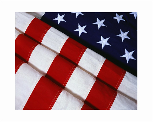 Folded American Flag by Corbis