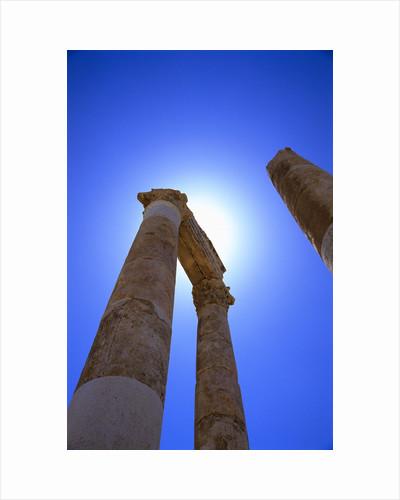 Columns Blocking Sun by Corbis