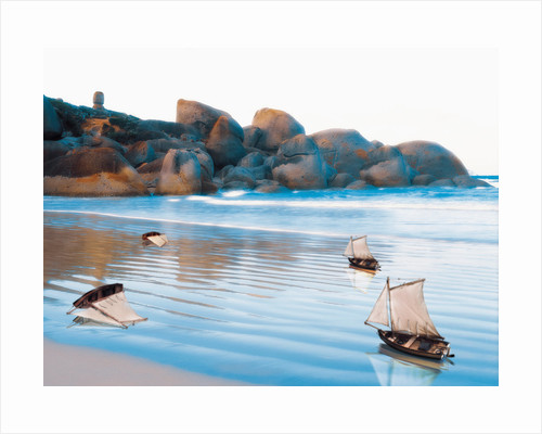 Toy Boats on Rocky Beach by Corbis