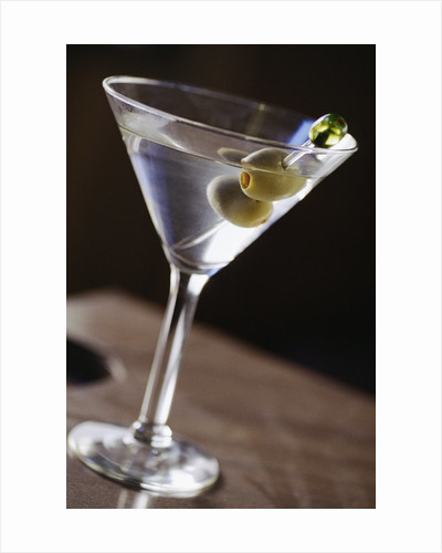 Olives in Martini Glass by Corbis