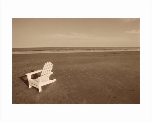 Lone Chair on Empty Beach by Corbis