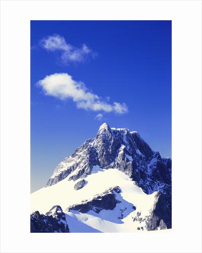 Snow Covered Mountain Peak by Corbis