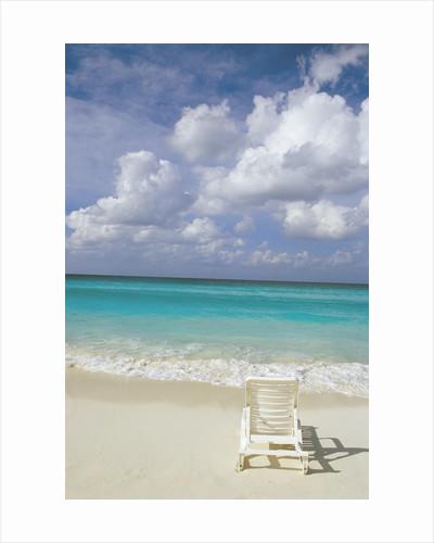 Lone Lounge Chair on Sandy Beach by Corbis