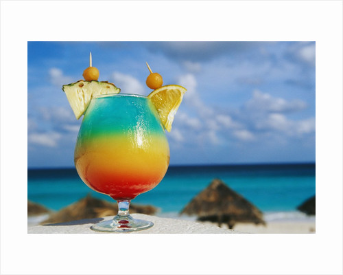 Tropical Drink Before Beach and Ocean by Corbis