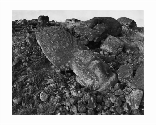 Moai Lies on Rocks and Boulders by Corbis