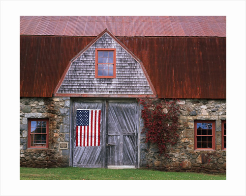 Flag Hanging on Barn Door by Corbis