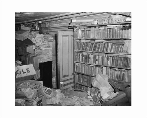 Interior View of a Room Full of Books and Cartons by Corbis