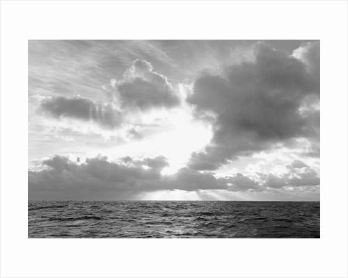 Sunrise over Ocean Water by Corbis