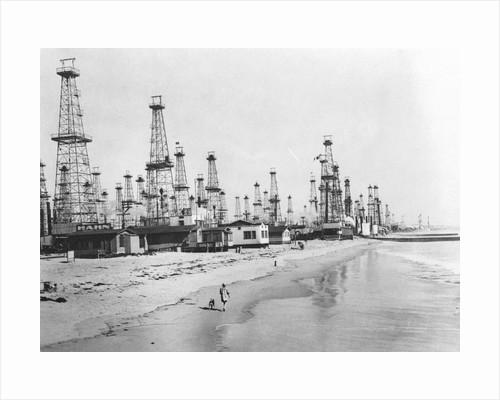 Oil Derricks on a Beach in California by Corbis