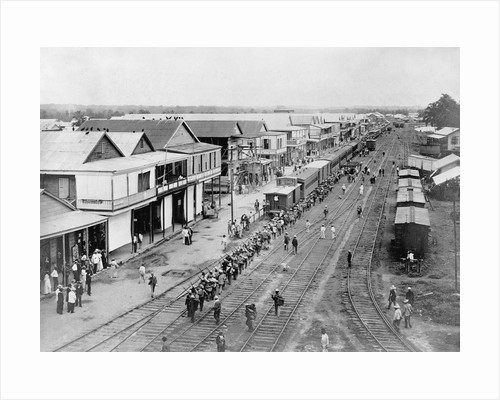 Overview of Town and Railroad Tracks by Corbis