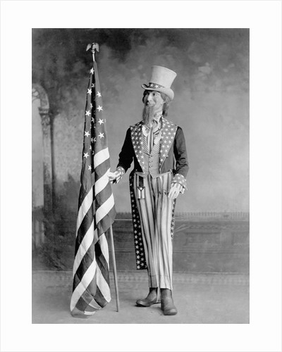 Wooden Uncle Sam and the American Flag by Corbis