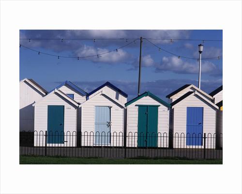 Beach Huts on Devon Town's Waterfront by Corbis