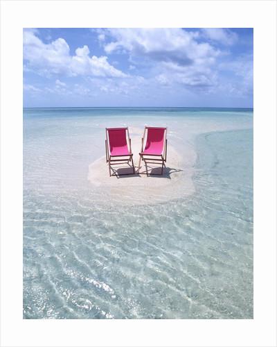 Folding chairs on an Australian beach by Corbis