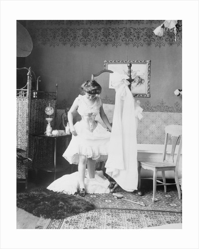 Victorian Woman Undressing in the Bath by Corbis