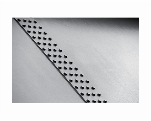 Bolts in Steel Plate by Corbis