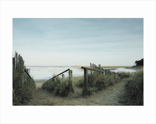 Railing Converging on a Beach by Corbis