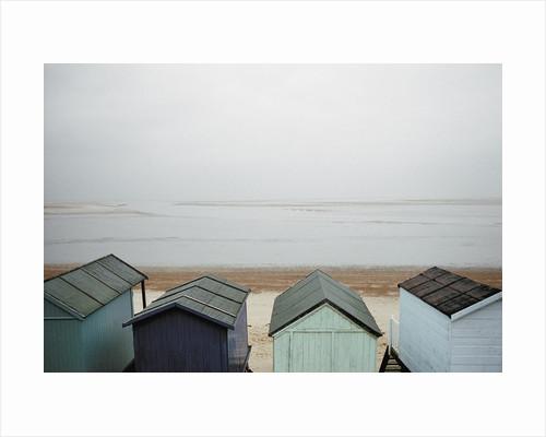 Cabanas on Empty Beach by Corbis