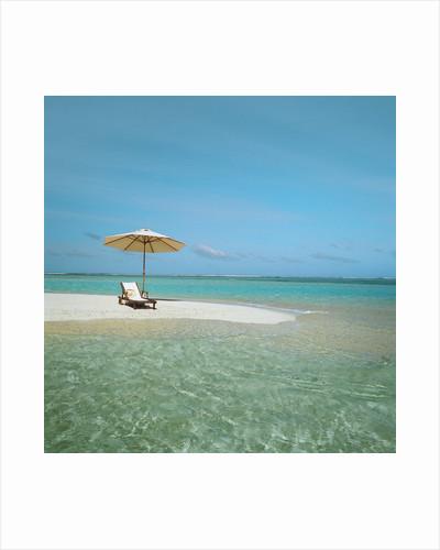 Umbrella and Beach Chair on the Beach by Corbis