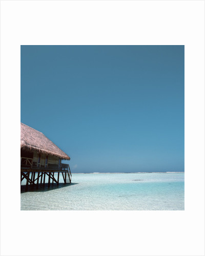 Beach Hut Over Shallow Water by Corbis